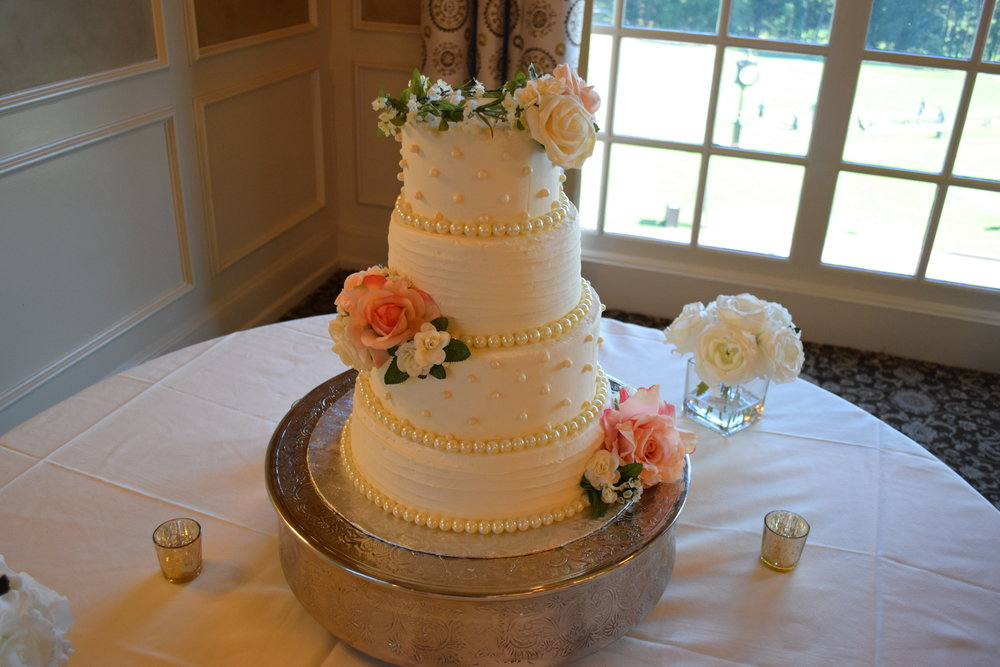 Spiral Iced and Pearled White Velvet Wedding Cake with a Faux Pearl Boarder and Floral Accents