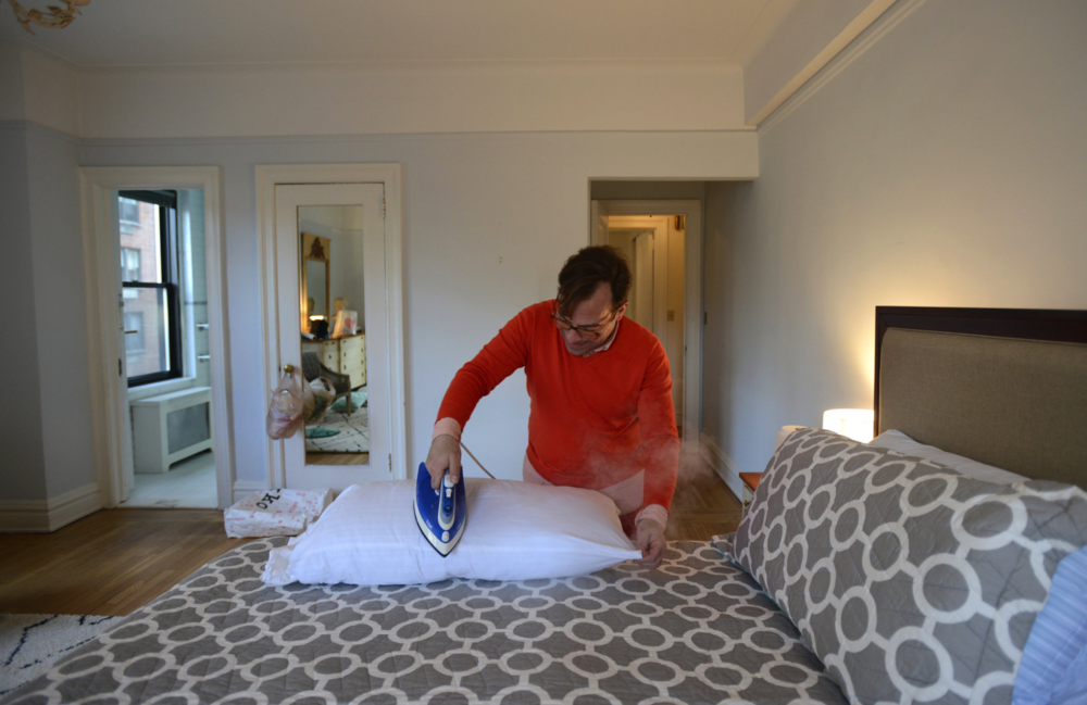 The Art of Home Staging - David C. Salvatore, of Edge Mid-Century Designs, irons a pillowcase while staging an apartment.By TIM McKEOUGH JAN. 22, 2016Credit: Jennifer S. Altman for The New York Times