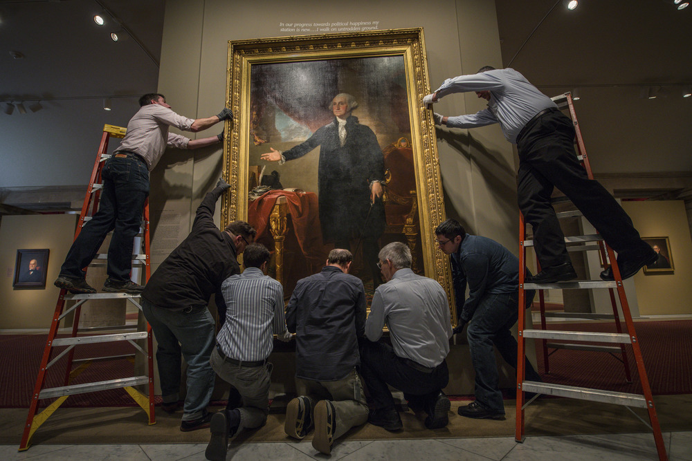 "Gilbert Stuart's iconic ""Lansdowne"" portrait of George Washington is taken down to undergo conservation analysis and treatment over the next 18 months at the Smithsonian's National Portrait Gallery on Monday, Feb. 29, 2016, in Washington, D.C."