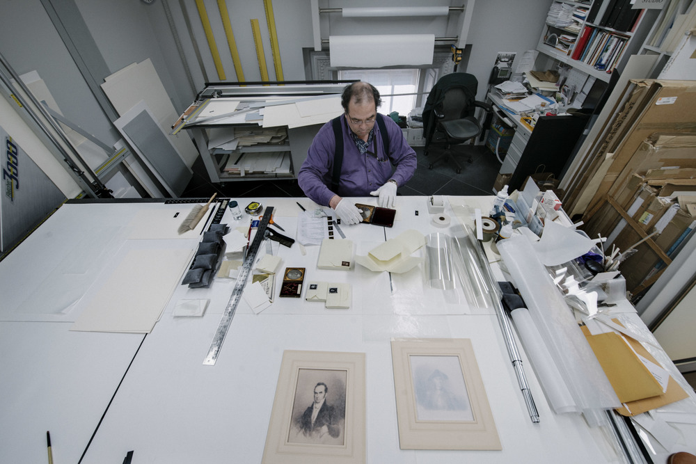 Smithsonian National Portrait Gallery Library Mat Cutter Edmund Myers measures an artwork at NPG's conservation lab in Washington, DC, Tuesday, Apr. 12, 2016. The lab recoveries paper, photos and other artworks.