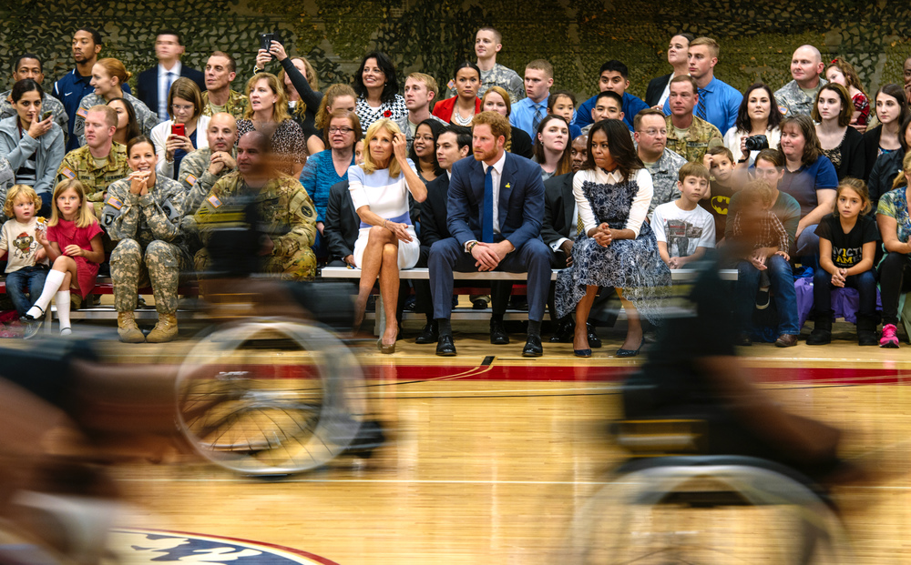 (L to R) Dr. Biden, HRH Prince Harry, First Lady Michelle Obama - As part of their Joining Forces Initiative and in celebration of the upcoming Invictus Games, First Lady Michelle Obama and Dr. Jill Biden join HRH Prince Harry for a visit to Fort Belvoir, on Wednesday, October 28, 2015.