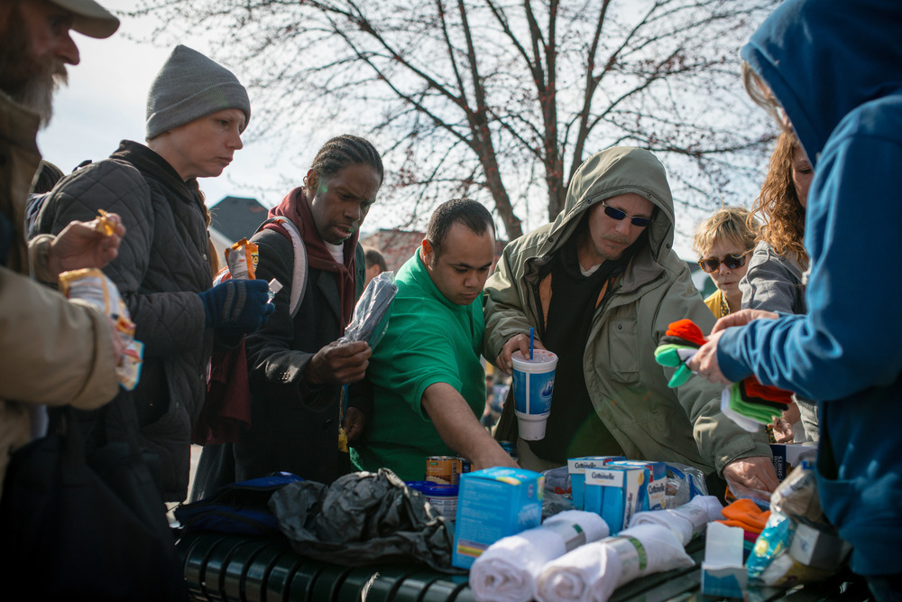 Bloomington Shelter closes after winter, homeless people tries to prepare food at People's Park, April 3rd, 2014.