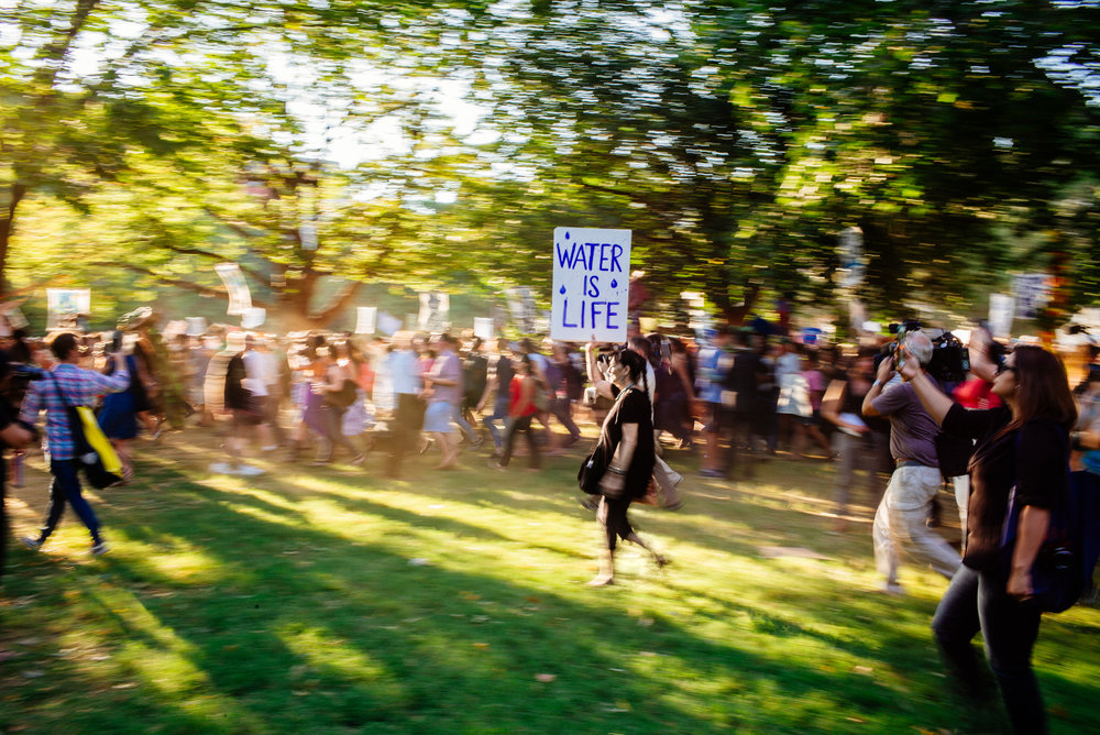 A protester walks to The White House North Lawn during North Dakota pipeline rally on Tuesday, September 13.