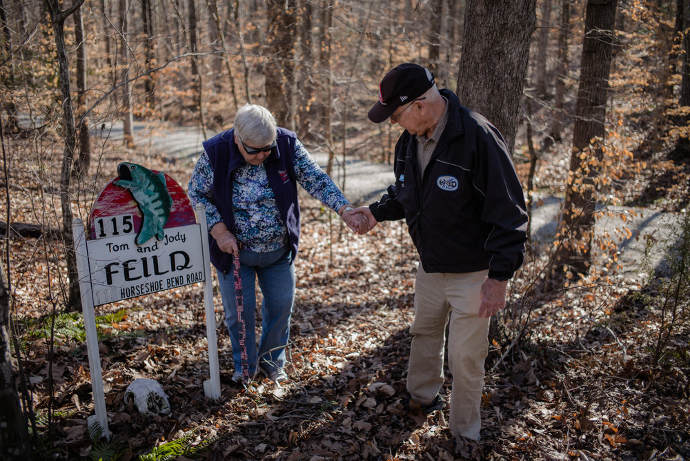 Thomas C. Field, 78, helps his wife Josephine A. Field, 78, in front of the house sign with their names on Monday, February, 6th, 2017 in Littleton, North Carolina.
