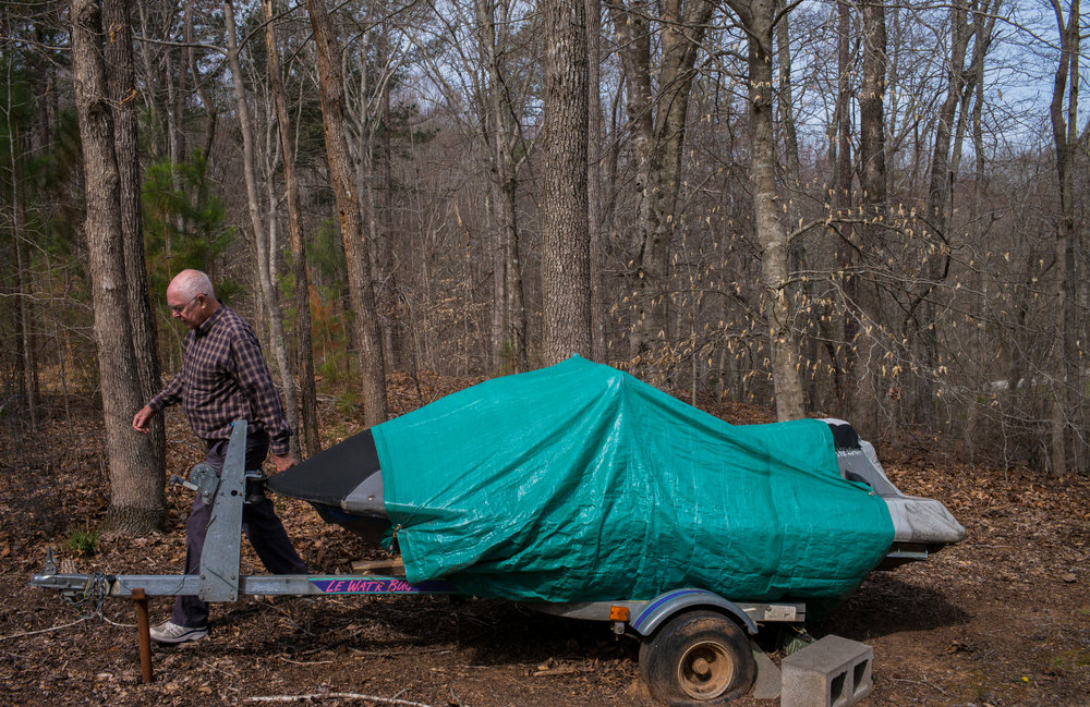 Thomas C. Field, 78, passes by his another boat on Saturday, March 25, 2017 in Littleton, North Carolina. Tom has to sell his two boats, dock and the house in order to move to his son's place in Maryland.