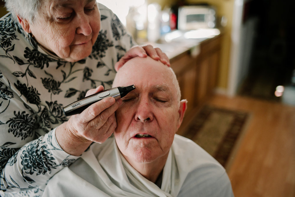 Josephine A. Field 78, trims eyebrows for Tom in their Lake Gaston house on Monday, February, 13th, 2017 in Littleton, North Carolina.