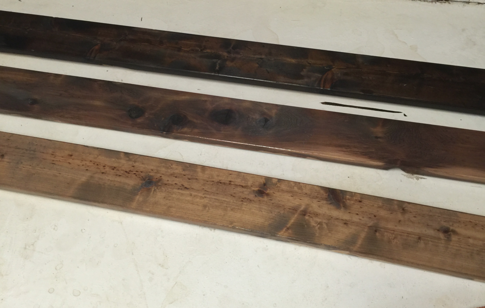 I started by staining with Minimax stain.  The top board is Expresso, the middle board is Dark Walnut and the bottom Weathered Oak.  I stained the sides so if the boards were uneven you would not see unstained wood.  We used new pine boards from Home Depot (our weekend date night hangout).