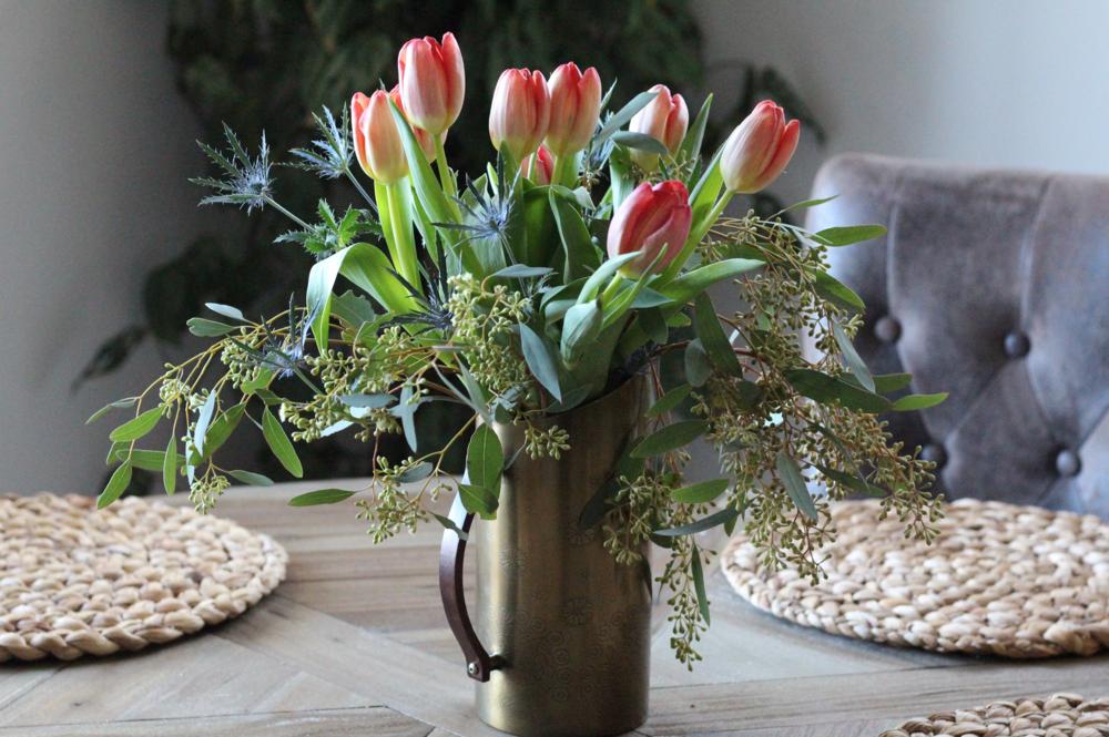 Tulips in copper vase