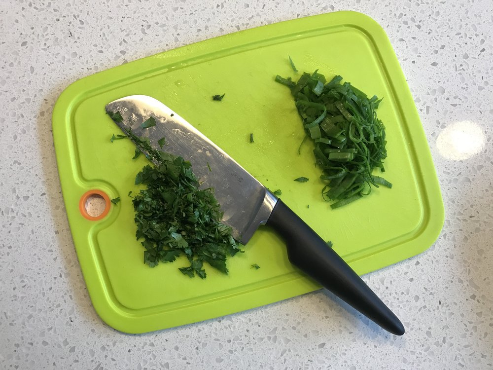 Cilantro and green onion are common in Thai dishes. You can omit the cilantro if that's not your steez.