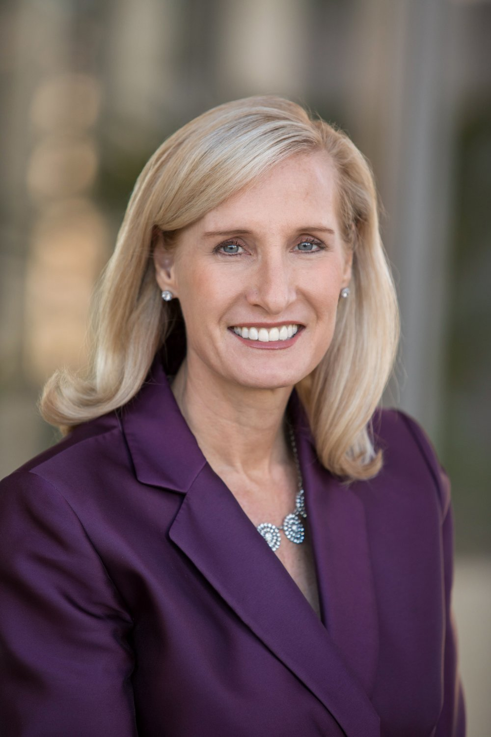 Professional corporate headshot and team photography for Merrill Lynch financial advisors and directors women.
