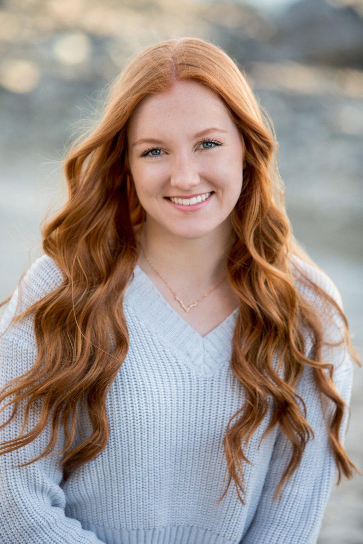 High school senior girl with long red hair