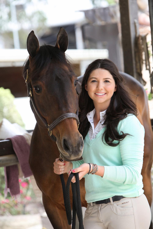 High school senior girl with her horse