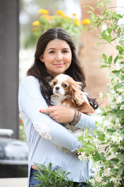 High school senior girl with her dog