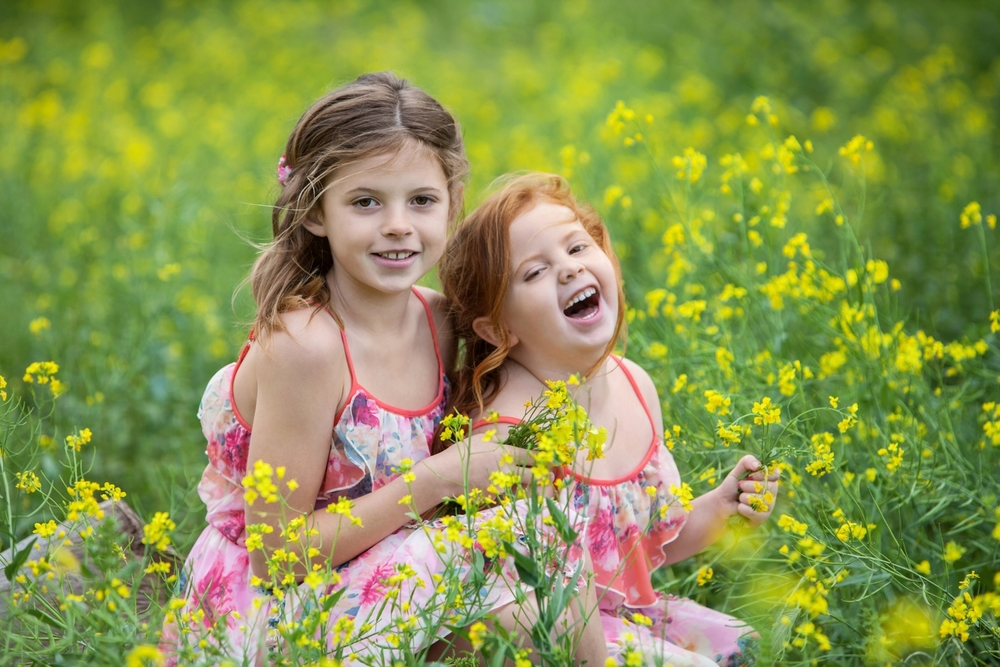 Pretty young girls outdoors in the flowers