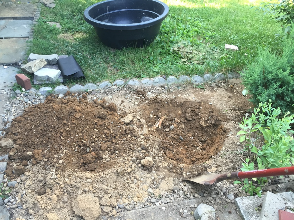 Starting to dig the hole for my backyard pond