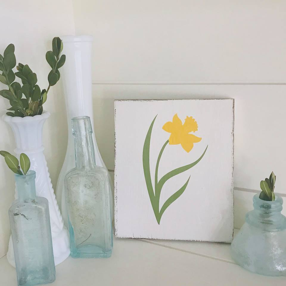 Daffodil sign and vintage bottles