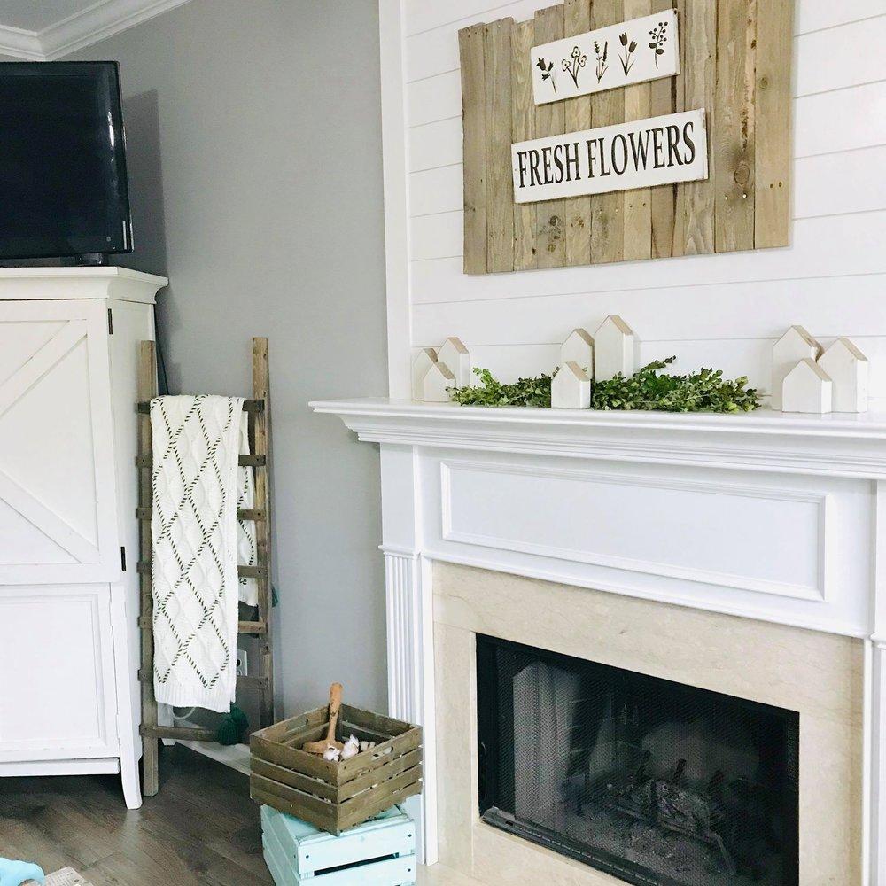 shiplap fireplace with greenery.jpg