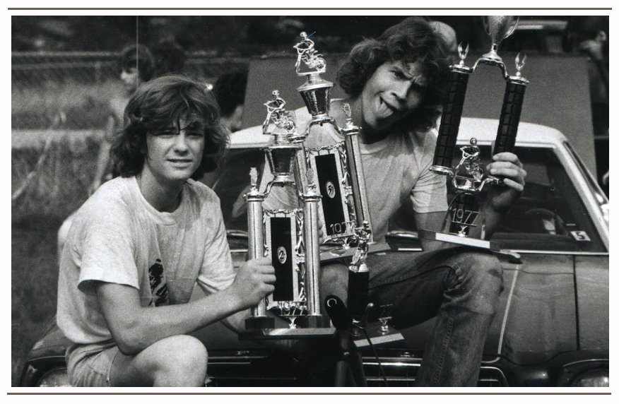 Showing off the spoils of a weekend BMX race during the Summer Tour 1976. Brad (left side)