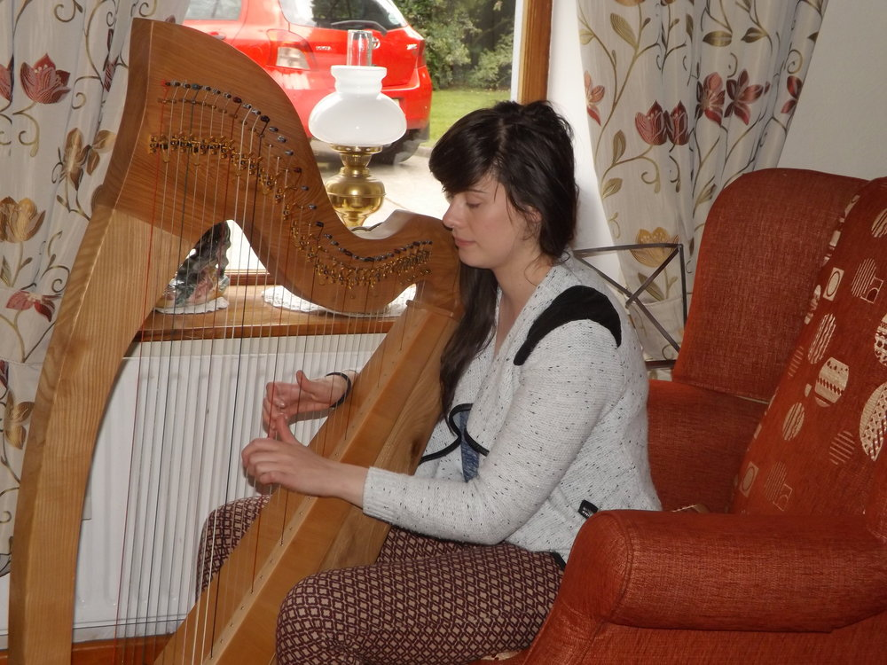 ... playing the harp...