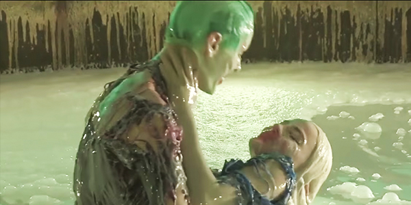 The Joker and Harley Quinn kissing in a vat of goo Suicide Squad