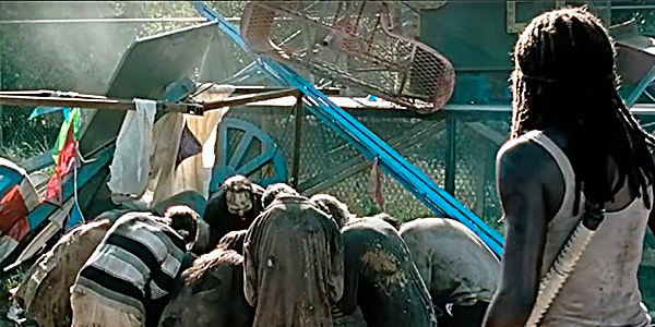 Michonne looks on as Rick is seemingly consumed by the dead