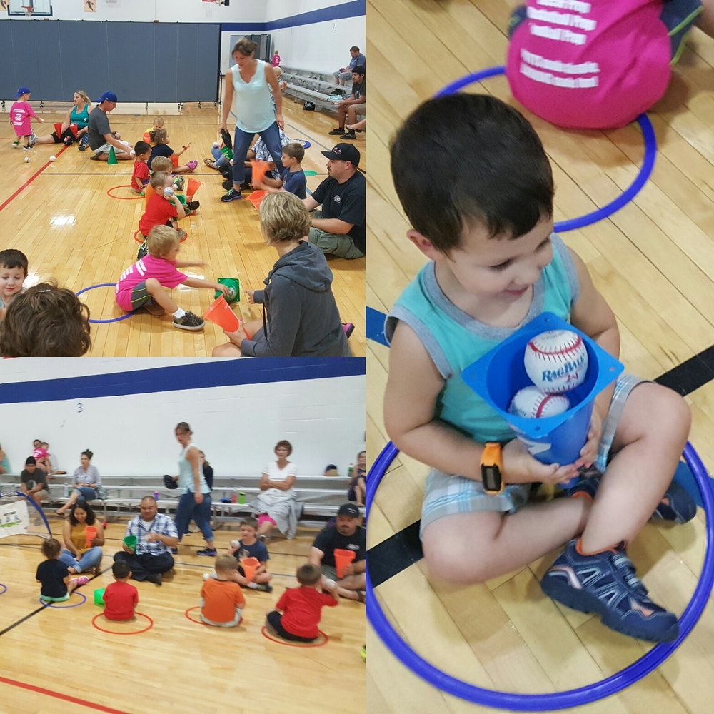 children catching baseballs with cones