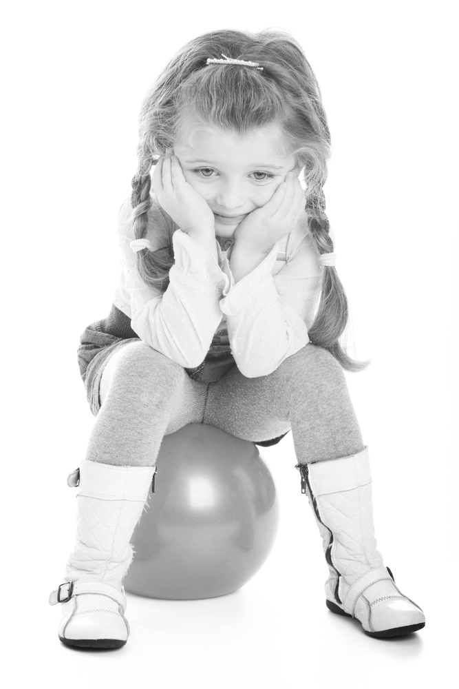 girl sits on a ball
