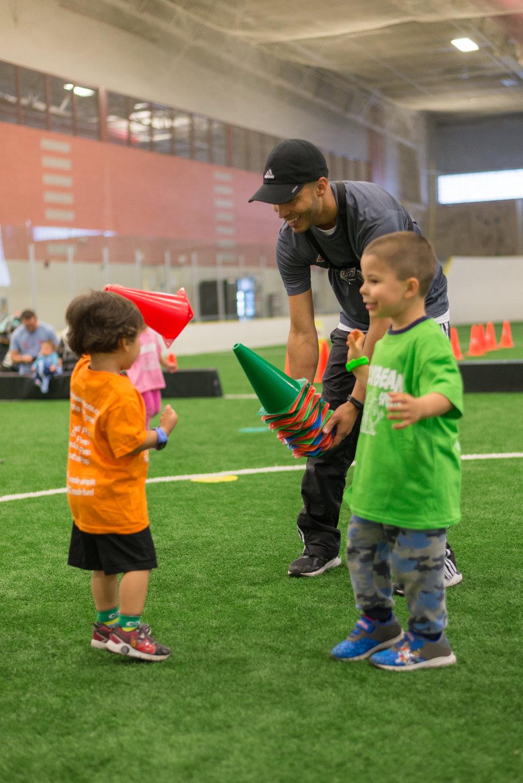 Boy gives coach cone.jpg