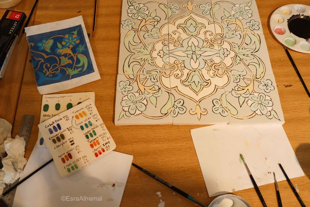 Painting a floral design on ceramic tiles