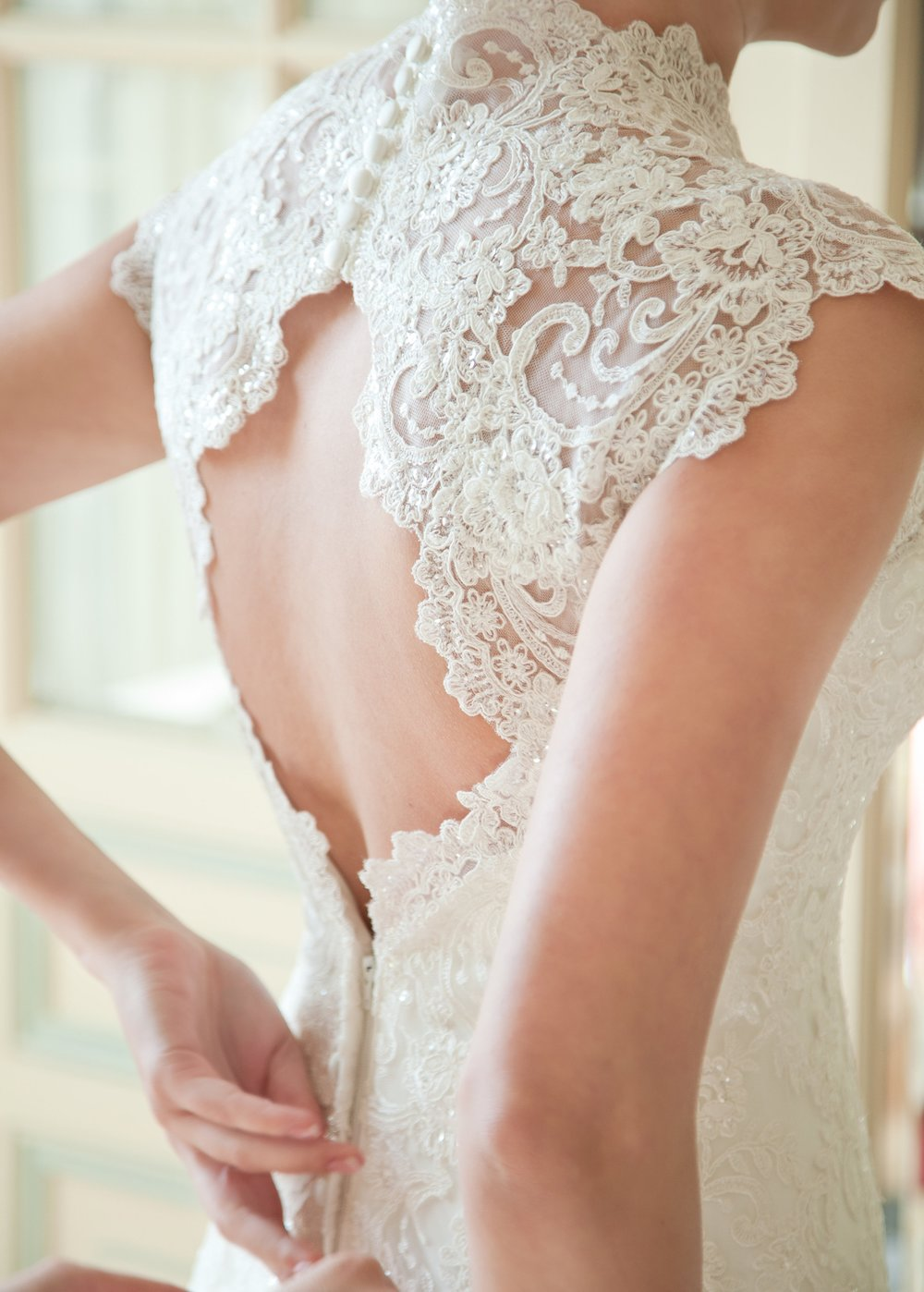 So many beautiful wedding dresses draw attention to the bride's back.
