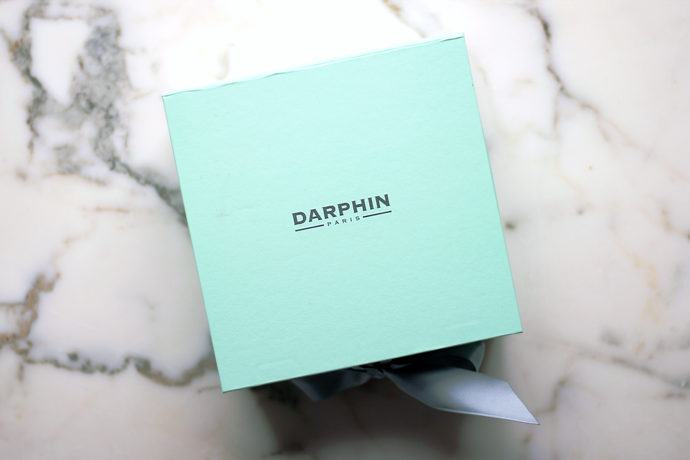 Right:  A limited edition Darphin box designed by Nicolas Ouchenir using watercolors. Just so pretty!  Top:  The usual gift box in its beautiful signature robin egg's blue hue.