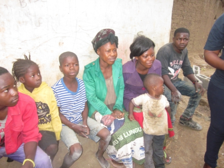 This is a picture of a Zambian family helped by a previous Habitat build.