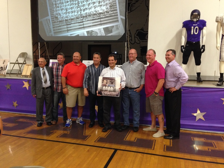 Tony Pusateri with 2014 Night of Tradition honoree Guido Ricevuto and members of the 1985 State Championship Football Team