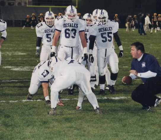 Former All-Ohio performer Kurt Murphy '96, a 2001 Assistant Coach, works with Stallion linemen