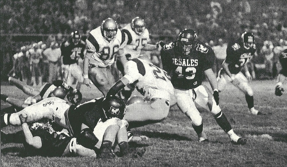 Grant Bowman (51) and Chris Leonard (43) slow down an Eagle as part of a 49-yard rushing performance by Bishop Watterson