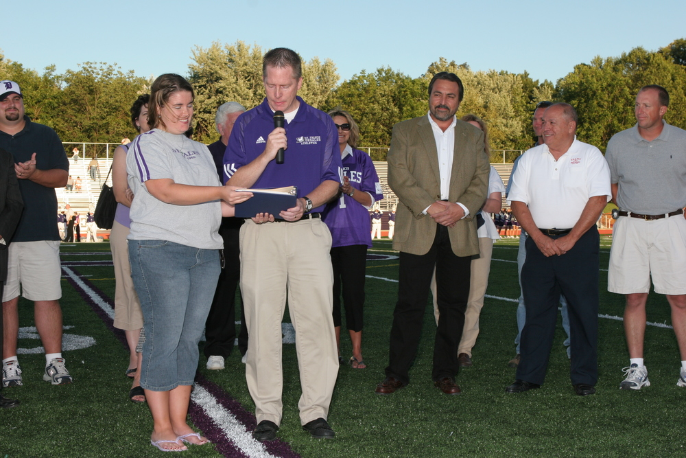 SFD Principal Dan Garrick address the crowd before the first football game in newly renovated Alumni Stadium