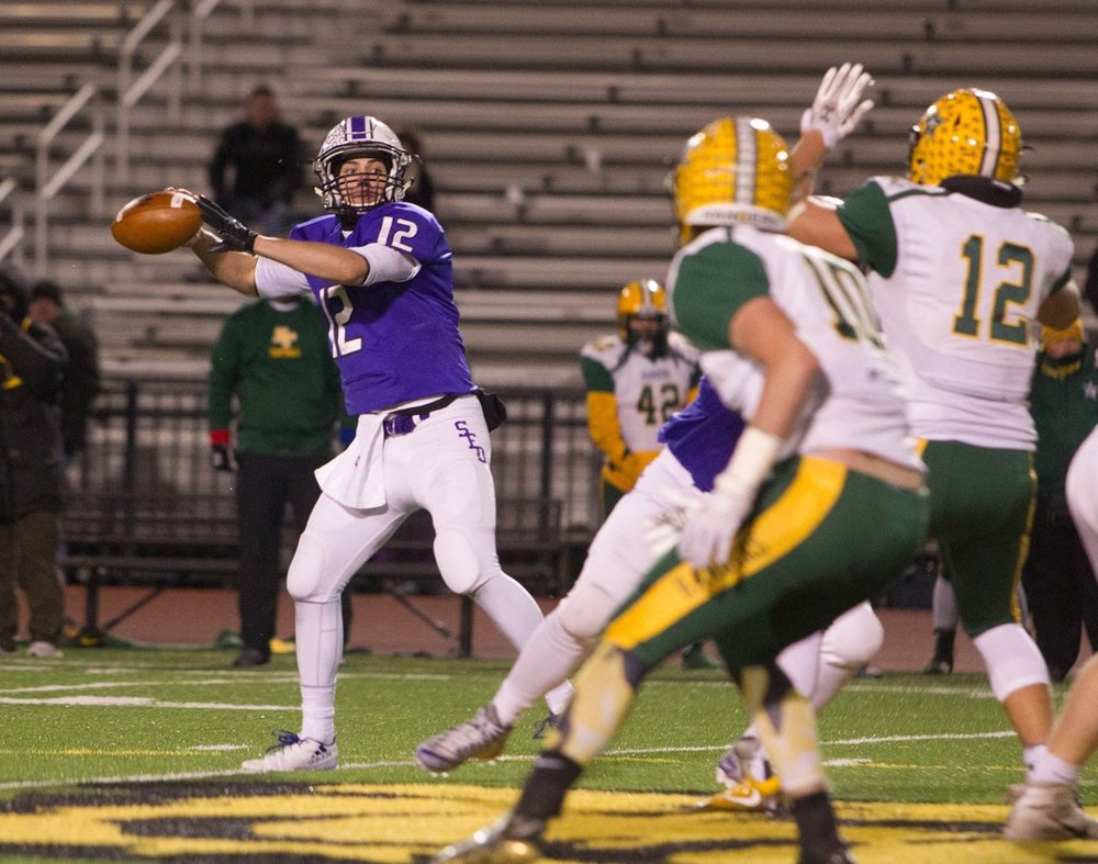Junior quarterback Cole Silvestri (12) threw for 2 touchdowns and rushed for another as the Stallions captured their 11th Regional Championship