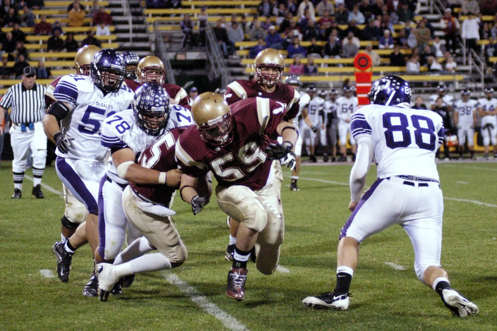 Smith (78) makes a tackle in the 2008 Watterson game at Crew Stadium
