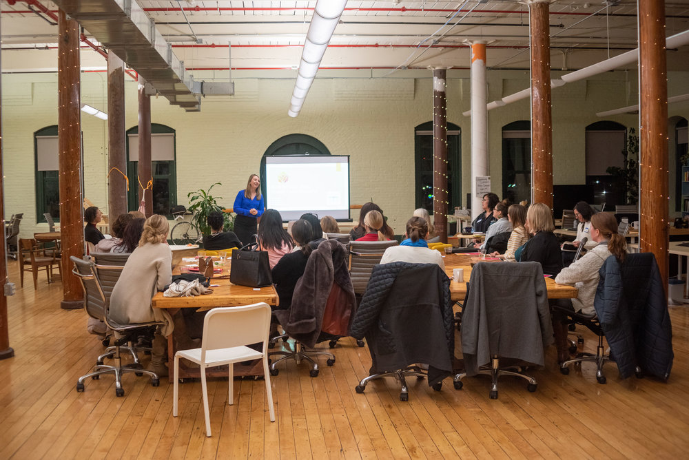 Ashley Pare speaking at a salary negotiation workshop in Boston, MA