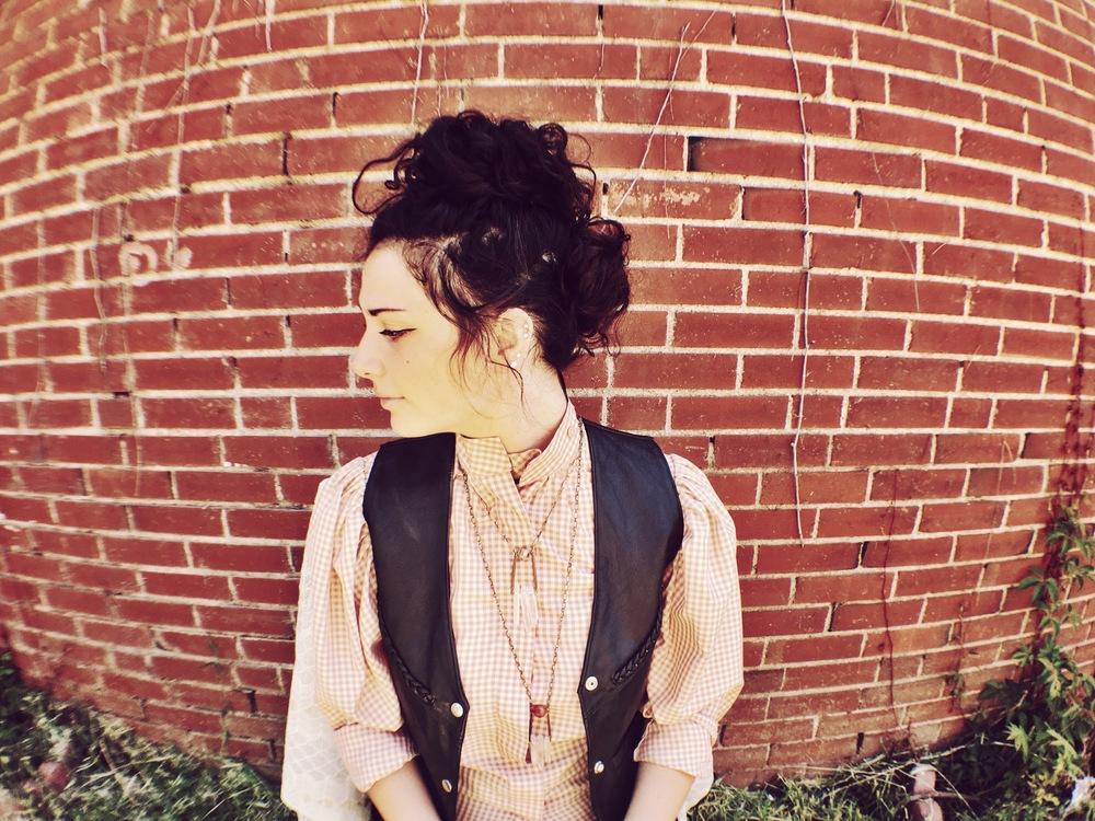 vintage collared shirt; $22 vintage leather vest;