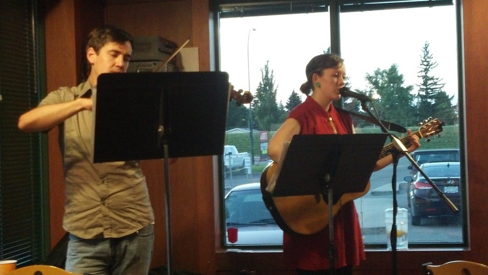 Michael and I performing at Prairie Ink in Saskatoon, circa 2012. Check out those music stands!