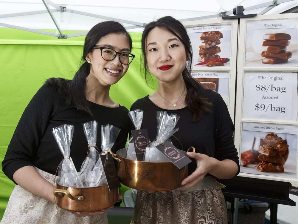 Tammy Lok (left) and Alysia Lok at their Caramia Caramels booth at the City Market Downtown on Saturday May 21, 2016.IAN KUCERAK KUCERAK, IAN/IAN KUCERAK/EDMONTON SUN
