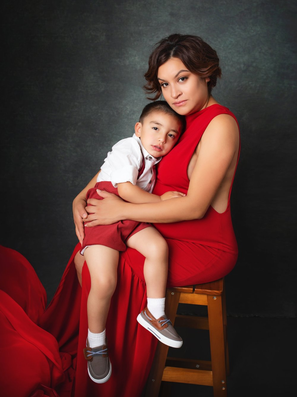 I wasn't expecting to bring my little boy to my Maternity session, but Maria encouraged me. I was worry he wouldn't cooperate, I am so glad we brought him. I now have a gorgeous portrait of my two babies. - -Michelle Torrez