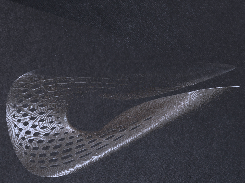 The small step lines in the steel that follow the surface topology are traces of the 3d printing process