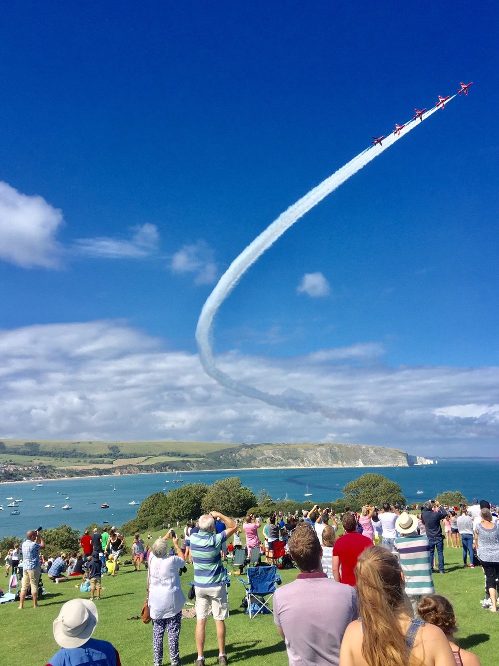 Summer is great back home in Swanage with lots of activities going on. After years of clashes and being away I finally was able to be around during carnival week and had a great time. Here is a picture from one afternoon watching the Red Arrows perform, shame I couldn't be sailing at the same time!