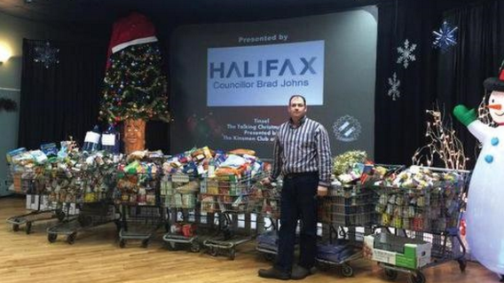 Brad Johns with 2015 donations for Beacon House.Image courtesy of Tinsel, The Talking Christmas Tree's team