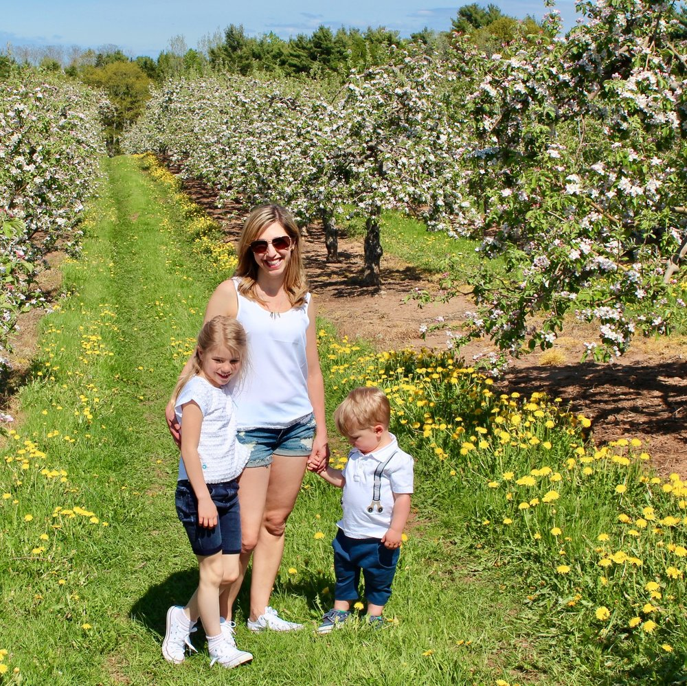 Sarah, Amelia and Ewan exploring the apple blossoms in the Valley