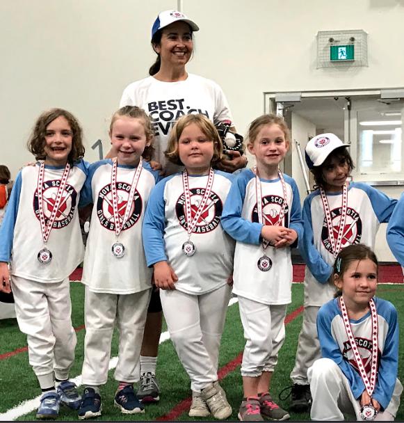 Last summer's team photo with Coach Alex (photo courtesy of Canadian Girls Baseball)