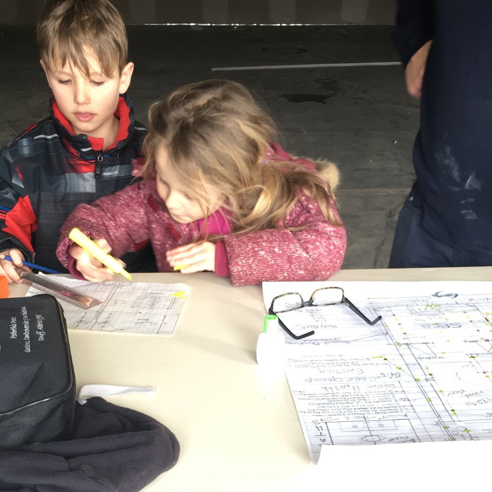 Future entrepreneurs working on plans for the new studio ( Image courtesy of Anna Townsend)