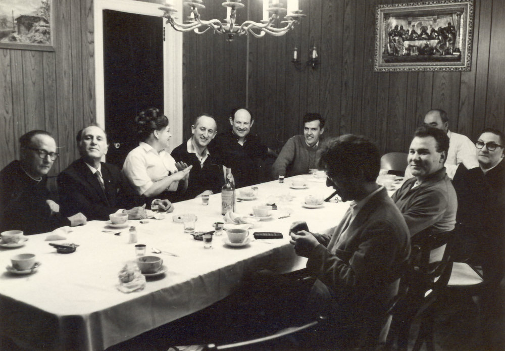 Dinner party with composer Francisco de Madina (far left)